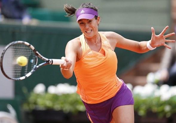 Muguruza juega en dobles con la española Carla Suarez.